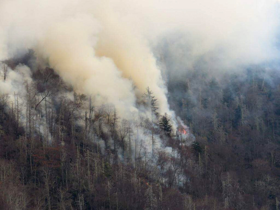 Smoke plumes from wildfires are shown in the Great Smokey Mountains near Gatlinburg